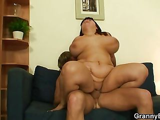 Huge titted plumper jumps on his cock