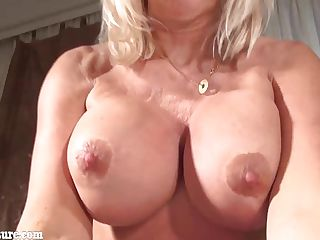 Granny with big tits masturbating in the bedr